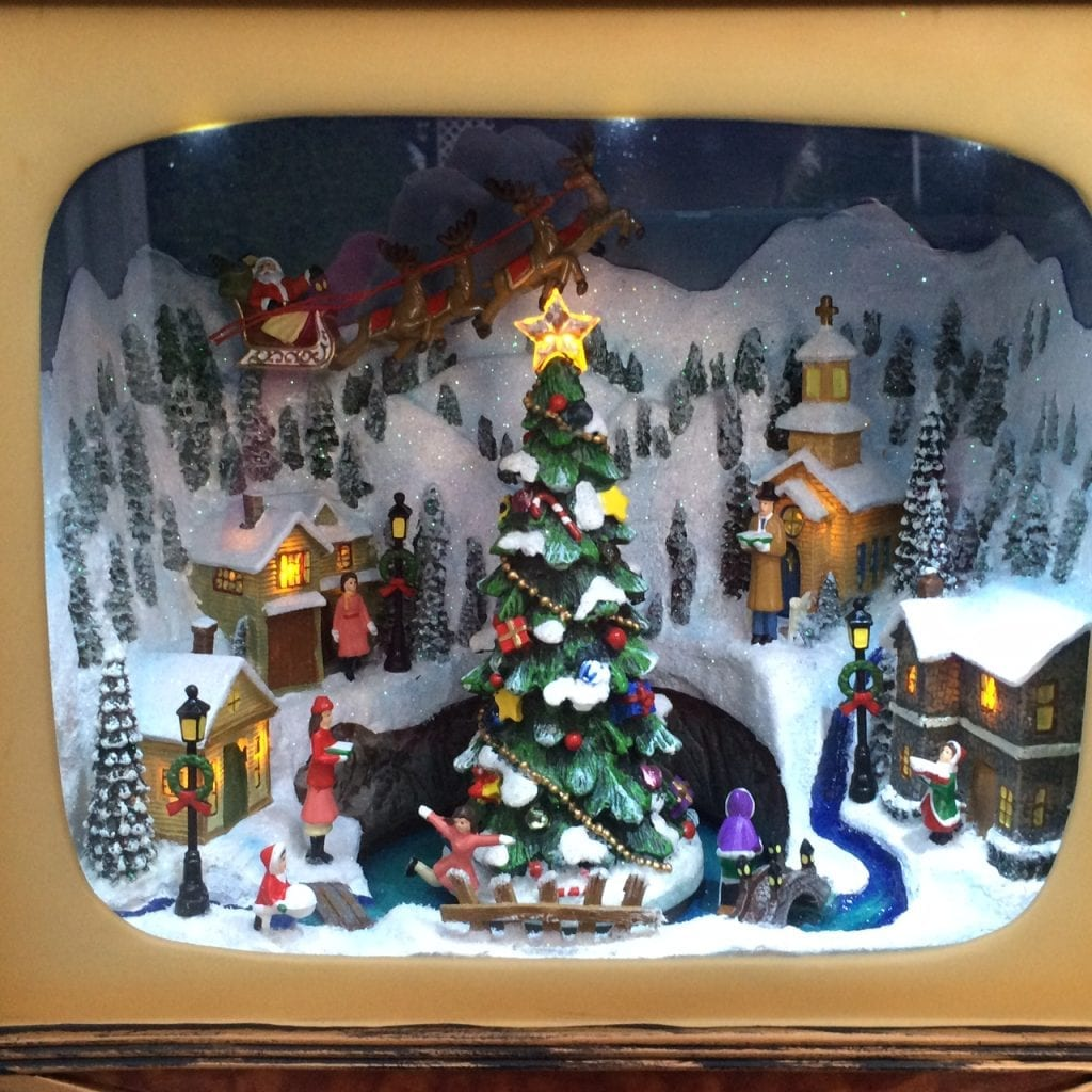 flashback to yester year with this fun and nostalgic retro tv set decoration the vintage television screen depicts a quaint lighted christmas village